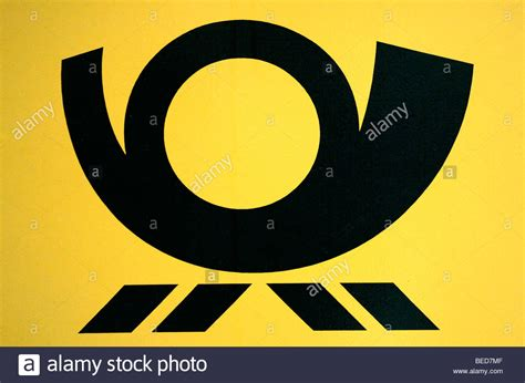 Logo of the Deutsche Post AG on a yellow postbox Stock
