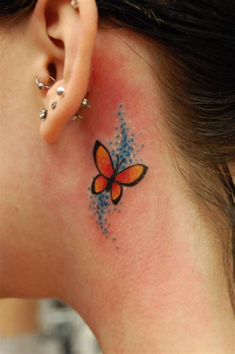 This tiny butterfly tattoo is pretty cute, hiding behind